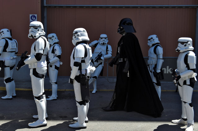 People wearing Star Wars costumes are seen during the parade in Metropoli (Media Culture and Entertainment Festival) in Gijon, northern Spain, July 3, 2016. (Photo by Eloy Alonso/Reuters)