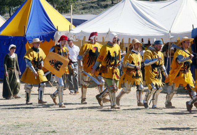 Teams from all over the world gathered for the International Medieval Combat competition at the castle of Belmonte in Belmonte, Spain, in May, to fight in the style of 14th century Europe – complete with full suits of armor and authentic period weaponry. (Photo by Europa Press/Getty Images)