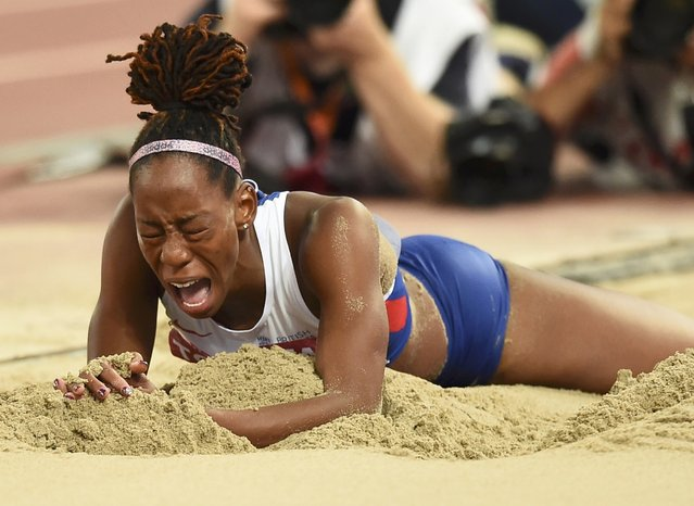 Shara Proctor of Britain reacts as she competes in the women's long jump final during the 15th IAAF World Championships at the National Stadium in Beijing, China, August 28, 2015. (Photo by Dylan Martinez/Reuters)