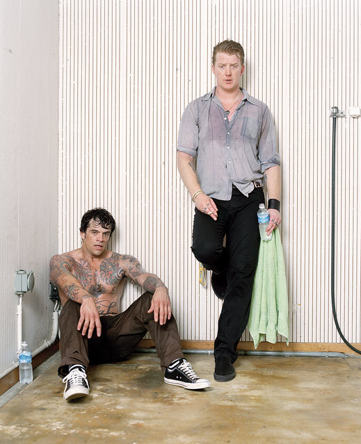 """""""The Moment After the Show"""": Joey Castillo and Josh Homme of Queens Of The Stone Age. (Photo by Matthias Willi/Olivier Joliat/The Moment After The Show)"""