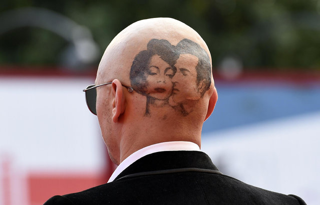 A view of US actor-director James Franco's shaved head with a tattoo of actors Montgomery Clift and Elizabeth Taylor as he arrives for the premiere of 'The Sound and the Fury' during the 71st annual Venice International Film Festival, in Venice, Italy, 05 September 2014. The movie is presented out of competition at the festival running from 27 August to 06 September. (Photo by Claudio Onorati/EPA)