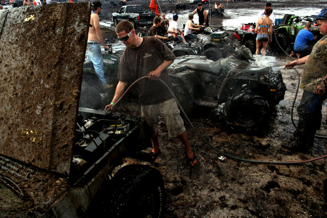 Caleb Upthegrove of West Palm Beach joins others in cleaning their vehicles. (Photo by Gary Coronado/The Palm Beach Post)