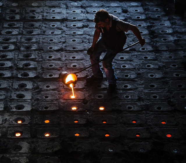 """Metal worker"". People making money from molten iron. Photo location: Turkey. (Photo and caption by Murat Yılmaz/National Geographic Photo Contest)"
