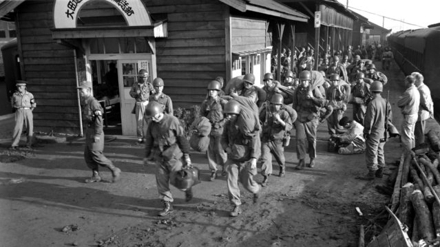 The first units of U.S. Army ground forces to arrive debark from trains somewhere in South Korea, 1950. (Photo by Sgt. Turnbull)
