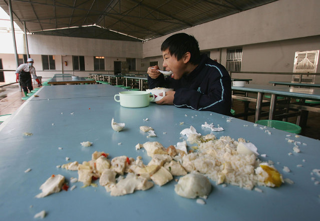 A kid eats his lunch at an assistance center February 23, 2005 in Shenzhen, Guangdong Province, China. (Photo by Cancan Chu/Getty Images)