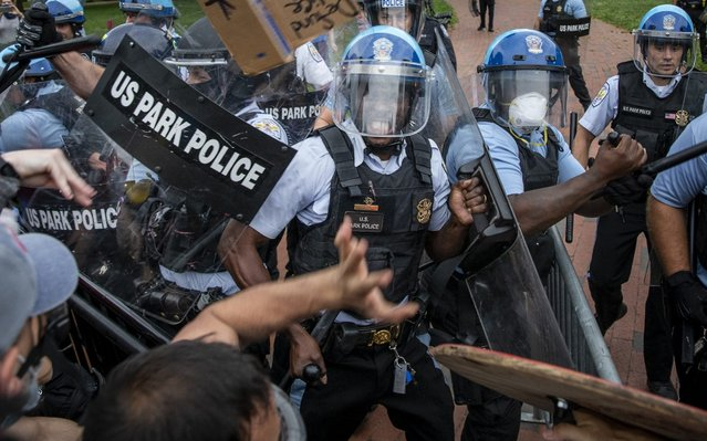 Protesters clash with U.S. Park Police after protesters attempted to pull down the statue of Andrew Jackson in Lafayette Square near the White House on June 22, 2020 in Washington, DC. Protests continue around the country over the deaths of African Americans while in police custody. (Photo by Tasos Katopodis/Getty Images)