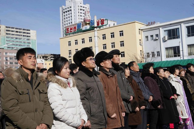 People watch the news broadcast announcing North Korean leader Kim Jong Un's order to test-fire the newly developed inter-continental ballistic missile Hwasong-15, Wednesday, November 29, 2017, at the Pyongyang Train Station in Pyongyang, North Korea. (Photo by Jon Chol Jin/AP Photo)