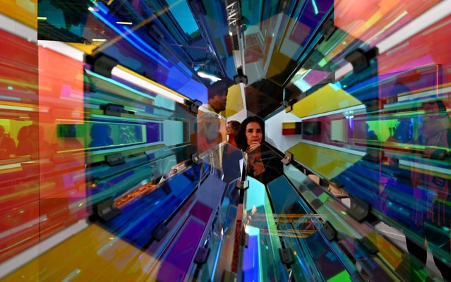 A woman looks at an artwork by Danish-Icelandic artist Olafur Eliasson during the International Contemporary Art Fair (ARCO) in Madrid on February 26, 2020. (Photo by Gabriel Bouys/AFP Photo)