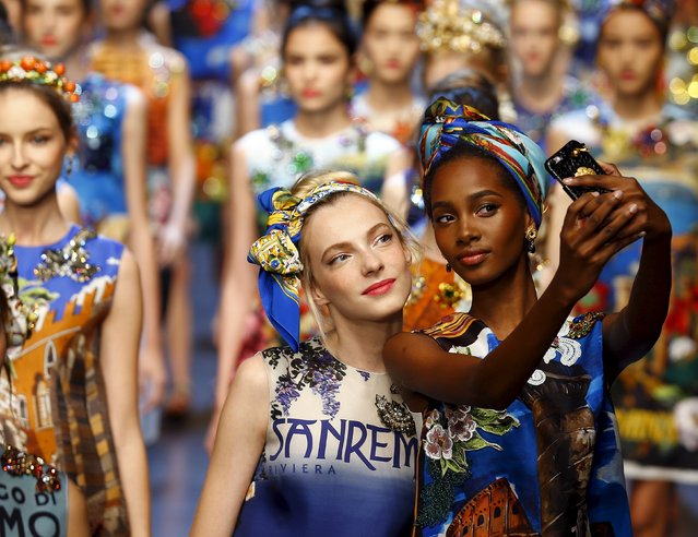 Models take selfie with mobile phone as they present creations from the Dolce & Gabbana Spring/Summer 2016 collection during Milan Fashion Week in Italy, September 27, 2015. (Photo by Stefano Rellandini/Reuters)