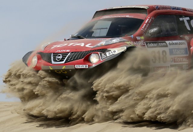 France's Christian Lavieille and co-pilot Jean-Michel Polato compete with their Proto Dessoude during the first stage of the Dakar Rally 2013 from Lima to Pisco January 5, 2013. (Photo by Jacky Naegelen/Reuters)