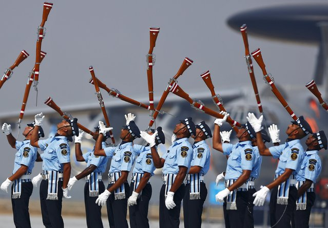 Indian Air Force soldiers toss their rifles as they perform during the full-dress rehearsal for Indian Air Force Day at the Hindon air force station on the outskirts of New Delhi October 6, 2015. (Photo by Anindito Mukherjee/Reuters)