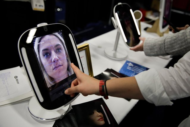 The HiMirror Mini, an internet-connected smart mirror with Amazon's Alexa, is displayed during CES Unveiled at CES International Sunday, January 7, 2018, in Las Vegas. (Photo by Jae C. Hong/AP Photo)