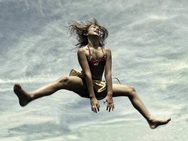 """""""Jumpology"""". """"Jump for Joy"""". Bruges, Belgium. (Photo by Yvette Depaepe)"""