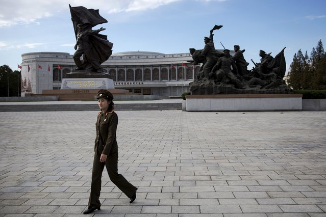 A soldier arrives to welcome foreign reporters and officials at the War Museum during a government organised tour in Pyongyang, North Korea October 9, 2015. (Photo by Damir Sagolj/Reuters)