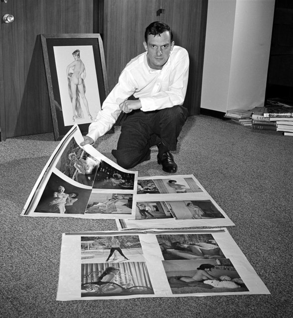 Publisher Hugh Hefner looks over proof sheets for his magazine Playboy, in Chicago, Ill., on June 20, 1961. Circulation of his glamor magazine has grown to 1, 200,000 copies since he started publication in 1953. (Photo by AP Photo)