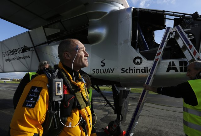 Swiss pilot Bertrand Piccard prepares for a test flight of the solar-powered Solar Impulse 2 experimental aircraft in Payerne November 13, 2014. The aircraft, weighing 2.4 tons with a wingspan of 72 meters, is fitted with more than 17,000 solar cells. An attempt to fly around the world in stages using only solar energy will be made in 2015. (Photo by Ruben Sprich/Reuters)