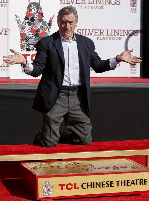 """US actor Robert De Niro shows off his hands after making an imprint in cement during a ceremony at the TCL Chinese Theatre in Hollywood, California USA, 04 February 2013.  De Niro, a two time Academy Award winner is currently nominated for an Academy Award for """"Best Supporting Actor"""" for his role in the film Silver Linings Playbook. (Photo by Bret Hartman/EPA)"""