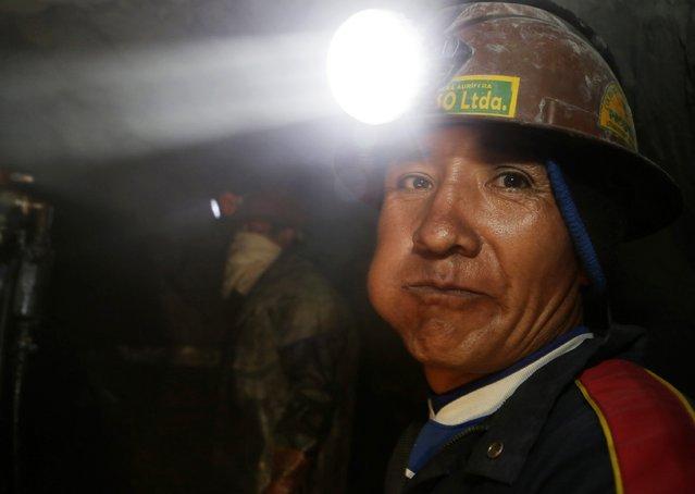 "A mine worker looks on at ""The Progreso"" gold mine near La Paz, November 13, 2014. (Photo by David Mercado/Reuters)"