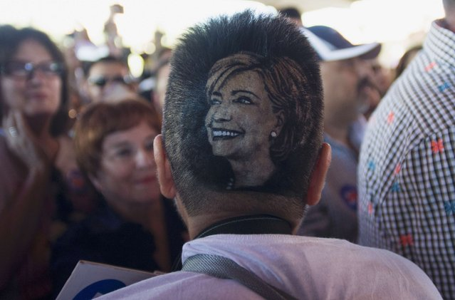 "Hillary Clinton supporter Maria Anita Monsivaiz shows off an image of Clinton cut into her hair style at a ""Latinos for Hillary"" presidential campaign rally in San Antonio, Texas October 15, 2015. (Photo by Darren Abate/Reuters)"