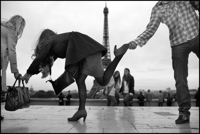 The Eiffel Tour-the body language of balance. I came across this group of young adults from Sarajevo, Bosnia, having fun testing their balance two nights ago in on the Esplanade de Trocadero. (Photo and comment by Peter Turnley)