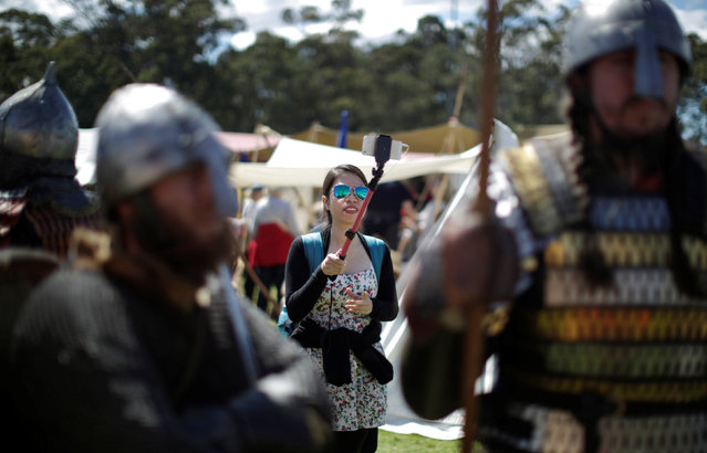 A spectator at the St Ives Medieval Fair, one of the largest of its kind in Australia, uses a selfie stick to takes a picture of participants dressed as warriors in Sydney September 24, 2016. (Photo by Jason Reed/Reuters)