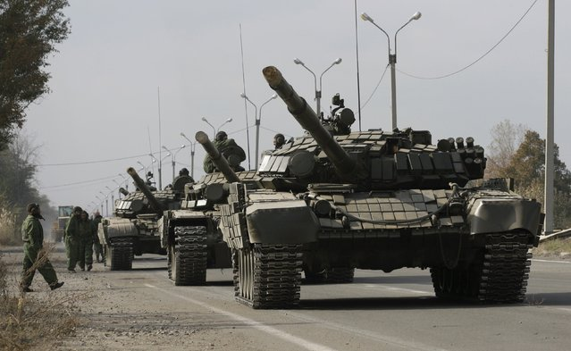 Tanks of the self-proclaimed Luhansk People's Republic (LNR) forces are parked on the roadside during a withdrawal, near the village of Bile in Luhansk region, Ukraine, October 20, 2015. (Photo by Alexander Ermochenko/Reuters)