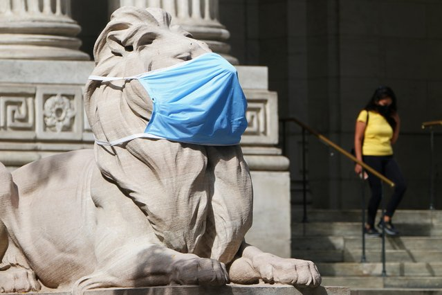 A lion statue that sits outside the New York Public Library building wears a mask in the Manhattan borough of New York City, New York, U.S., September 28, 2020. (Photo by Carlo Allegri/Reuters)