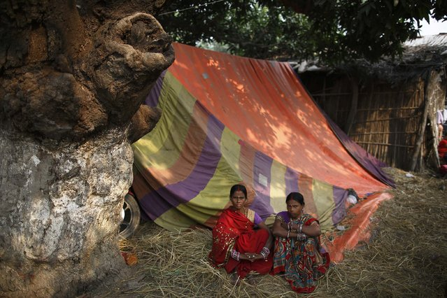 "Women sit outside their tent during the ""Gadhimai Mela"" festival held in Bariyapur November 29, 2014. (Photo by Navesh Chitrakar/Reuters)"