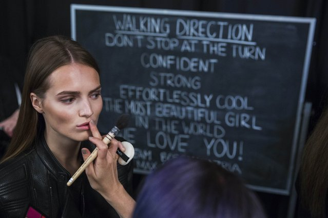 A model has make-up applied backstage before showing the BCBG Max Azria collection during New York Fashion Week, in this September 4, 2014 file photo. (Photo by Lucas Jackson/Reuters)