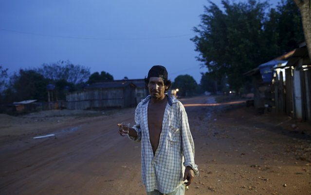 A man poses on the street in the village of Rio Pardo next to Bom Futuro National Forest, in the district of Porto Velho, Rondonia State, Brazil, August 31, 2015. (Photo by Nacho Doce/Reuters)