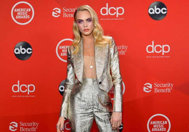 In this image released on November 22, English model, actress and singer Cara Delevingne attends the 2020 American Music Awards at Microsoft Theater on November 22, 2020 in Los Angeles, California. (Photo by Emma McIntyre/AMA2020/Getty Images for dcp)