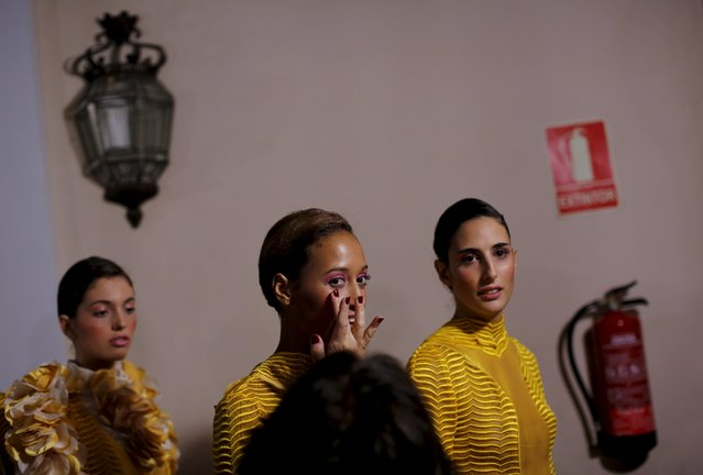 Models wait backstage to present creations by Fernando Claro during Andalucia de Moda (Andalusia Fashion) in Seville, southern Spain, November 10, 2015. (Photo by Marcelo del Pozo/Reuters)