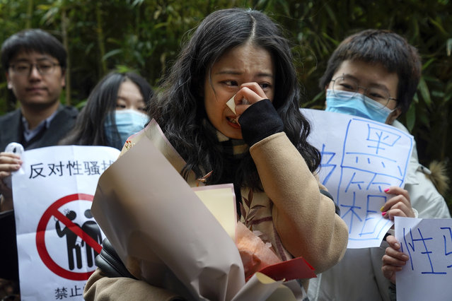 Zhou Xiaoxuan, center, weeps as she speaks to her supporters upon arrival at a courthouse in Beijing, Wednesday, December 2, 2020. Zhou, a Chinese woman who filed a sexual harassment lawsuit against a TV host, told dozens of cheering supporters at a courthouse Wednesday she hopes her case will encourage other victims of gender violence in a system that gives them few options to pursue complaints. (Photo by Andy Wong/AP Photo)