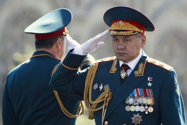 Russian Defence Minister Sergei Shoigu (R) salutes during the Victory Parade on Moscow's Red Square May 9, 2013. Russia commemorates the 68th anniversary of the Soviet Union's victory over Nazi Germany on May 9. (Photo by Sergei Karpukhin/Reuters)