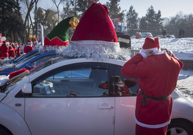 A reveler dressed as Father Frost, the equivalent of Santa Claus, adjusts his costume during a parade in Almaty December 28, 2014. (Photo by Shamil Zhumatov/Reuters)