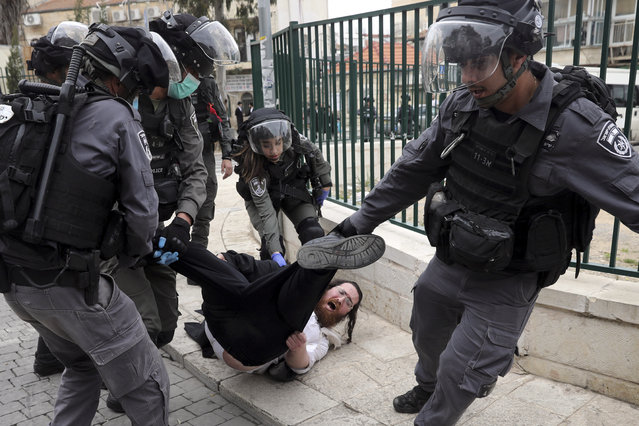 In this Monday, March 30, 2020 file photo, Israeli police arrest an Ultra Orthodox Jew during protest against government's measures to stop the spread of the coronavirus in the orthodox neighborhood of Mea Shearim in Jerusalem. (Photo by Mahmoud Illean/AP Photo/File)