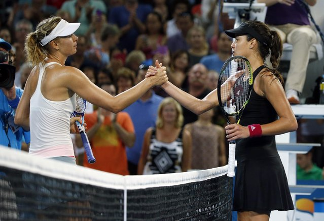 Maria Sharapova of Russia (L) meets Ana Ivanovic of Serbia at the net after Sharapova won their women's singles final match at the Brisbane International tennis tournament in Brisbane, January 10, 2015. (Photo by Jason Reed/Reuters)