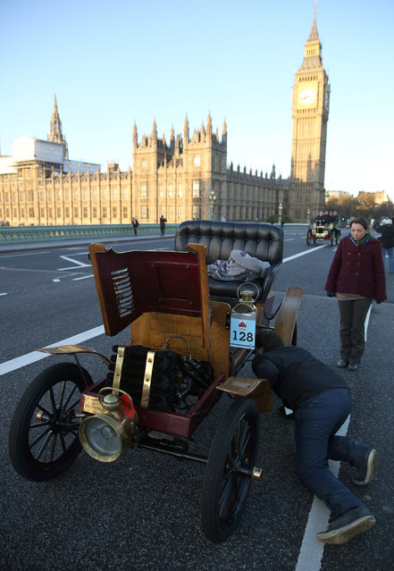 Participants inspect their vintage car after it had broken down during the annual London to Brighton veteran car run in London, Britain November 6, 2016. (Photo by Neil Hall/Reuters)