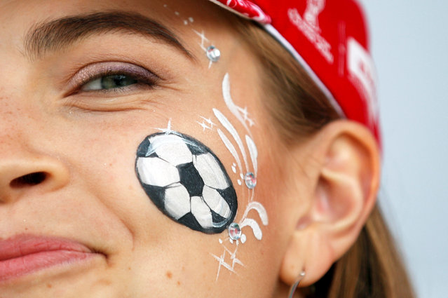 A fan with face paint outside the stadium before the group A match between Russia and Saudi Arabia which opens the 2018 soccer World Cup at the Luzhniki stadium in Moscow, Russia, Thursday, June 14, 2018. (Photo by Christian Hartmann/Reuters)