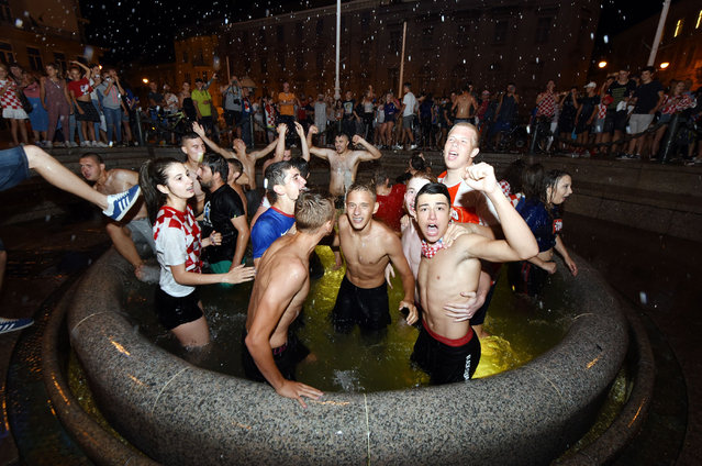 Croatia' s fans celebrate victory against Russia in the Croatian capital Zagreb' s main square after the 2018 FIFA World Cup Russia Round of 8 match between Russia and Croatia on July 7, 2018. (Photo by Denis Lovrovic/AFP Photo)