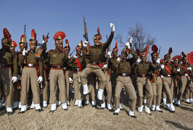 Indian Border Security Force (BSF) soldiers dance before their passing-out parade in Humhama on the outskirts of Srinagar January 30, 2015. A total of 333 recruits on Friday were formally inducted into the BSF, an Indian paramilitary force mostly deployed along the borders, after completing 44 weeks of rigorous training in physical fitness, weapons handling, anti-terrorism and protection of human rights, a BSF spokesman said. (Photo by Danish Ismail/Reuters)