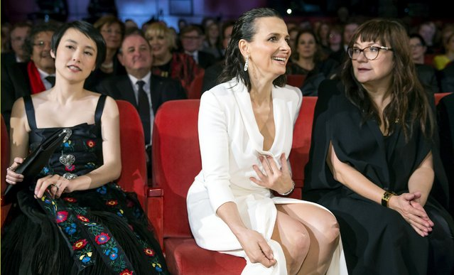 """Cast members Rinko Kikuchi, Juliette Binoche (C) and director Isabel Coixe (R) take their seats for the screening of the movie """"Nobody Wants the Night"""", during the opening gala of the 65th Berlinale International Film Festival, in Berlin February 5, 2015. (Photo by Hannibal Hanschke/Reuters)"""