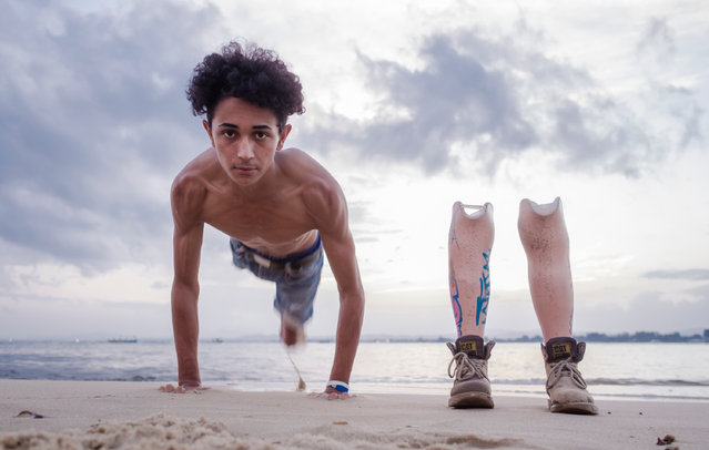 Guesmi pictured at the beach alongside his prosthetics, which are decorated with graffiti tags from his friends. (Photo by Yassine Alaoui Ismaili/The Guardian)
