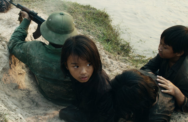 "This image released by Netflix shows Sareum Srey Moch in a scene from ""First They Killed My Father: A Daughter of Cambodia Remembers"". The film was nominated for a Golden Globe award for best foreign language motion picture on Monday, December 11, 2017. The 75th Golden Globe Awards will be held on Sunday, Jan. 7, 2018 on NBC. (Photo by Roland Neveu/Netflix via AP Photo)"