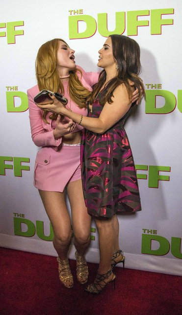 "Cast members Bella Thorne (L) and Mae Whitman greet each other at the premiere of ""The Duff"" at the TCL Chinese 6 Theatres in Hollywood, California February 12, 2015. The movie opens in the U.S. on February 20. (Photo by Mario Anzuoni/Reuters)"