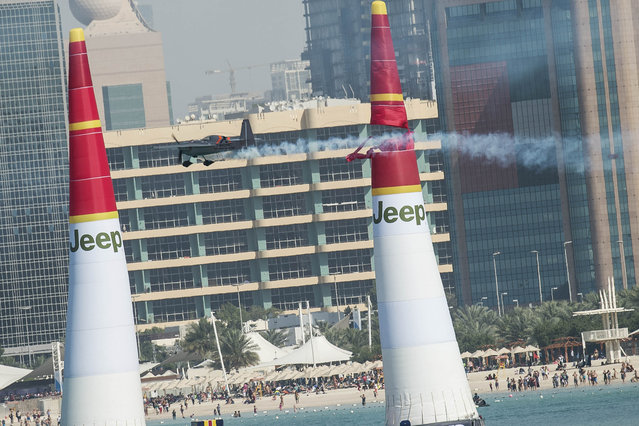 In this photo provided by Joerg Mitter via Global-Newsroom, Hannes Arch of Austria performs during the qualifying of the first stage of the Red Bull Air Race World Championship in Abu Dhabi, United Arab Emirates, Friday, February 13, 2015. (Photo by Joerg Mitter/AP Photo/Global-Newsroom)
