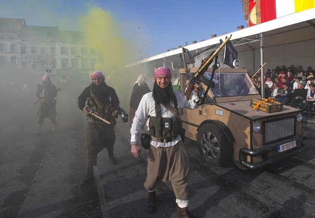 Revellers dressed as Islamic State militants take part in the 87th carnival parade of Aalst February 15, 2015. The Aalst Carnival, which is inscribed on the Representative List of the Intangible Cultural Heritage of Humanity, often shows informal groups presenting mocking interpretations of local and world events of the past year. (Photo by Yves Herman/Reuters)