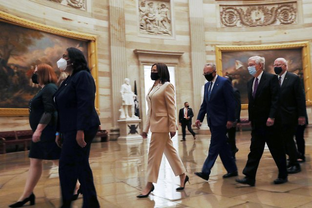 U.S. Vice President Kamala Harris leads a procession of senators through the Rotunda from the Senate Chamber to the House Chamber ahead of the first address by U.S. President Joe Biden to a joint session of the U.S. Congress at the U.S. Capitol in Washington, U.S., April 28, 2021. (Photo by Leah Millis/Reuters)