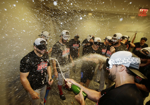 The Boston Red Sox celebrate after clinching the AL East title with an 11-6 win over the New York Yankees in a baseball game Thursday, September 20, 2018, in New York. (Photo by Frank Franklin II/AP Photo)
