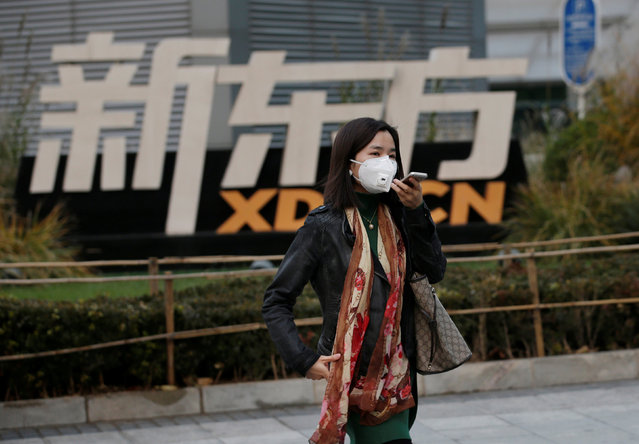 A woman walks past New Oriental Education & Technology Group headquarters in Beijing, China, November 16, 2016. (Photo by Jason Lee/Reuters)